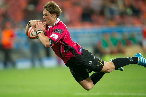 One of the two stalwarts, Justin van Staden, scores a try